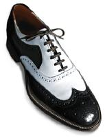 Black and white spectator wingtip lace up dress shoes